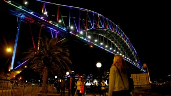 SYDNEY, AUSTRALIA - JUNE 13: The Sydney Harbour Bridge is illuminated with rainbow colors to remember victims of the Orlando night club massacre on June 13, 2016 in Sydney, Australia. 50 people were killed and 53 injured after a gunman opened fire on people in a gay nightclub in Florida. It is the deadliest mass shooting in US history. (Photo by Daniel Munoz/Getty Images)