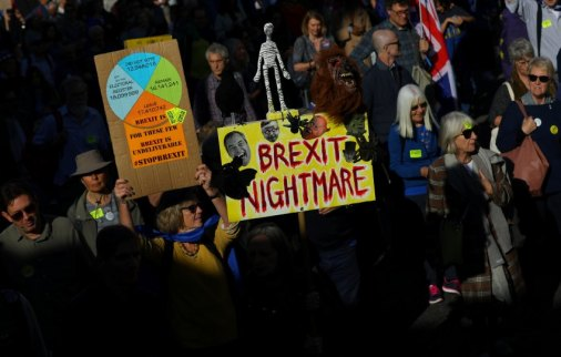 Protesters participating in an anti-Brexit demonstration march through central London